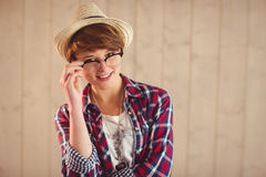 Pretty redhead holding her reading glasses Royalty Free Stock Photography