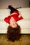 Pretty redhead lying on the couch Stock Photography