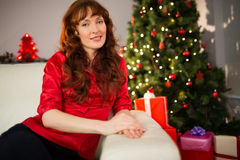 Pretty redhead posing on the couch at christmas Royalty Free Stock Photo