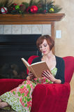 Pretty redhead reading a book Royalty Free Stock Photography