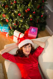 Pretty redhead relaxing on the couch at christmas Royalty Free Stock Photo