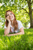 Pretty redhead relaxing in the park Royalty Free Stock Photos