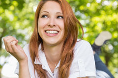 Pretty redhead relaxing in the park Royalty Free Stock Image