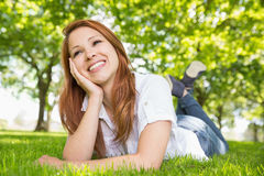 Pretty redhead relaxing in the park Stock Photography
