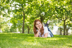 Pretty redhead relaxing in the park Royalty Free Stock Photography