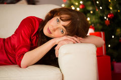 Pretty redhead relaxing on the sofa at christmas Royalty Free Stock Images
