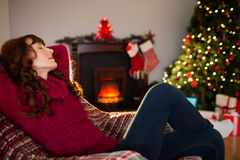 Pretty redhead resting on the armchair at christmas Royalty Free Stock Photos