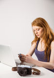 Pretty redhead sending text message Stock Photos