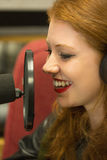 Pretty redhead student presenting a radio show Royalty Free Stock Photography