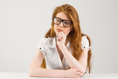 Pretty redhead thinking and looking down Stock Photos