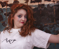 Pretty redhead woman against construction wall Royalty Free Stock Image
