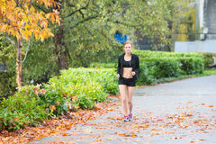 Pretty redhead woman jogging outside Stock Photo