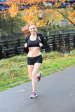 Pretty redhead woman jogging outside Royalty Free Stock Images