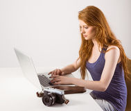 Pretty redhead working on laptop Stock Photography