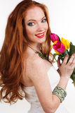 Pretty redheaded girl with bouquet of tulips. Beautiful redheaded girl with colorful tulips, woman's day Stock Images