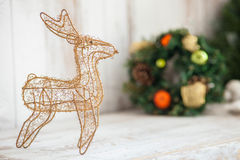 Pretty reindeer with pine garland is symbol of Stock Image