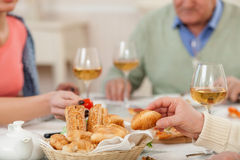 Pretty relatives are dining together at home Royalty Free Stock Photos