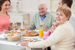 Pretty relatives have a lunch at home Royalty Free Stock Photos