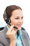 Pretty representative on the phone with earpiece Royalty Free Stock Photo