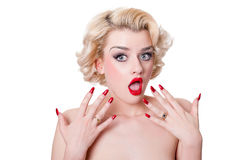Shocked retro blond beauty. Pretty retro blond looking shocked - isolated on white Royalty Free Stock Images