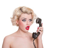 Shocked blond beauty on vintage telephone Royalty Free Stock Photography