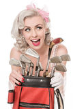Pretty retro girl with golf clubs and red golf bag, isolated on Royalty Free Stock Photo