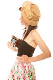 Pretty retro summer girl in hat taking picture using vintage camera. White background Stock Images