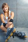 Pretty rollerskater. Cute teenage girl in roller skaters looking at camera Stock Image