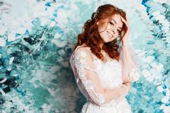 Pretty and romantic bride in wedding dress with long sleeves. Young redheaded woman in wedding dress stock images