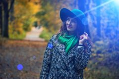Pretty romantic girl in clothes walks in a park. The mood of autumn, leaf fall. Autumn fashion. Royalty Free Stock Photos