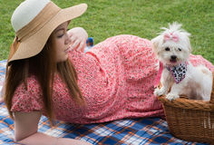 Pretty romantic girl with Maltese puppy. Pretty and romantic girl with Maltese puppy on picnic Stock Photo