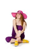 The pretty romantic girl in purple overalls isolated on white Stock Photography