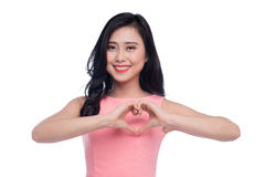 Pretty romantic young asian woman making a heart gesture with he Stock Photo