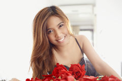 Pretty with roses c Stock Photo