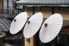 Japanese umbrellas and tiled roofes, Japan royalty free stock images
