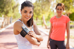 Pretty runner with an armband Royalty Free Stock Photos