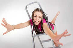 Pretty russian girl & step-ladder stock photos