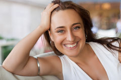 Pretty 30's woman on a date. Pretty and smiling 30's woman on a date Royalty Free Stock Photo