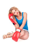 Pretty sad girl with boxing gloves Stock Photography