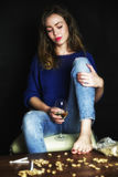 Pretty sad girl with glass of wine royalty free stock photography