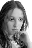 Pretty sad girl in grayscale. Portrait of a pretty sad girl. Shallow DOF Stock Photography