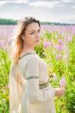 Pretty sad girl on meadow Royalty Free Stock Photos