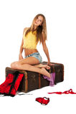 Pretty sad girl on old suitcase Royalty Free Stock Photos