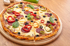 Pretty Salami and Vegetable Pizza Stock Photo
