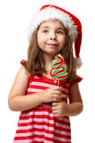 Pretty santa girl with christmas lollipop Stock Image