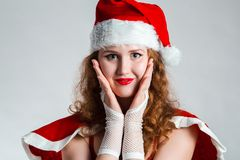 Pretty  Santa girl closeup portrait, holding present gift box isolated on white background Stock Images