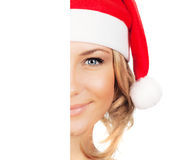 Pretty Santa girl with copy space Royalty Free Stock Photography