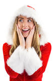 Pretty santa girl with hands on face Stock Images