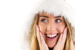 Pretty santa girl with hands on face Royalty Free Stock Photos