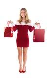 Pretty santa girl holding gift bags Stock Photo